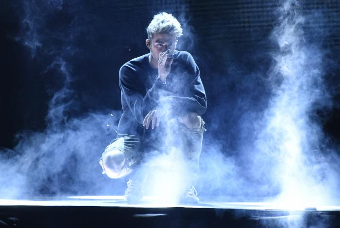 "Andrew Taggart, of The Chainsmokers, performs ""Sick Boy"" at WE Day California at The Forum in Inglewood, Calif."