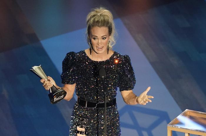 Carrie Underwood accepts the entertainer of the year award in a tie with Thomas Rhett during the 55th annual Academy of Country Music Awards.