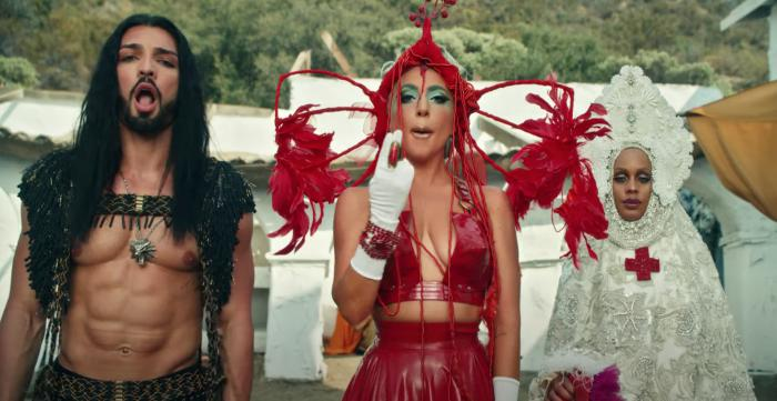 """Lady Gaga, center, in her music video for """"911."""""""