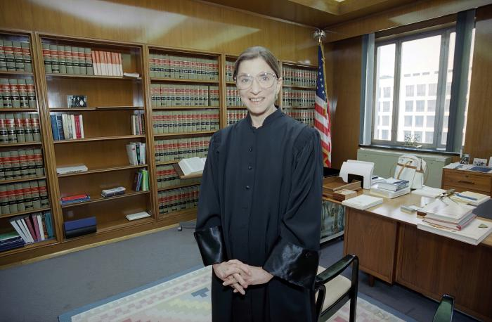 In this Aug. 3, 1993, file photo, then-Judge Ruth Bader Ginsburg poses in her robe in her office at U.S. District Court in Washington.In this Aug. 3, 1993, file photo, then-Judge Ruth Bader Ginsburg poses in her robe in her office at U.S. District Court in Washington.