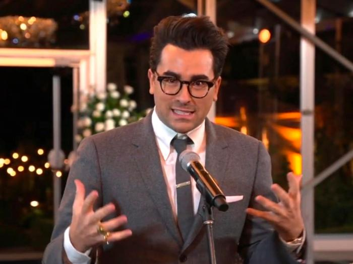 """In this video grab captured on Sept. 20, 2020, courtesy of the Academy of Television Arts & Sciences and ABC Entertainment, Daniel Levy accepts the award for outstanding writing for a comedy series for """"Schitt's Creek"""" during the 72nd Emmy Awards broadcast"""