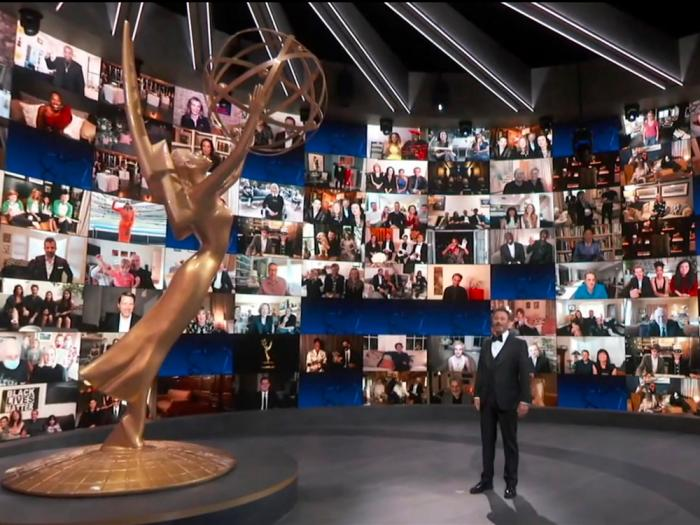 In this video grab captured on Sept. 20, 2020, courtesy of the Academy of Television Arts & Sciences and ABC Entertainment, host Jimmy Kimmel appears with a screen filled with nominees during the 72nd Emmy Awards broadcast