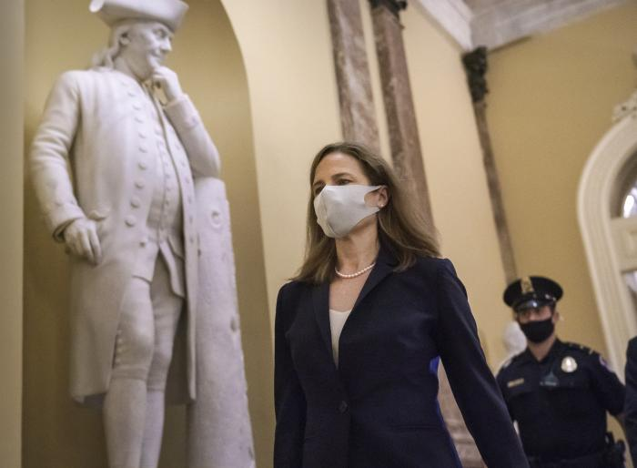 Judge Amy Coney Barrett, President Donald Trump's nominee for the Supreme Court, arrives for closed meetings with senators, at the Capitol in Washington.
