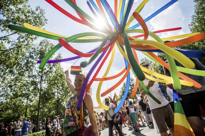 Participants walk towards the Parliament building during the Pride March of the 21th Budapest Pride LGBTQ Festival in Budapest, Hungary.