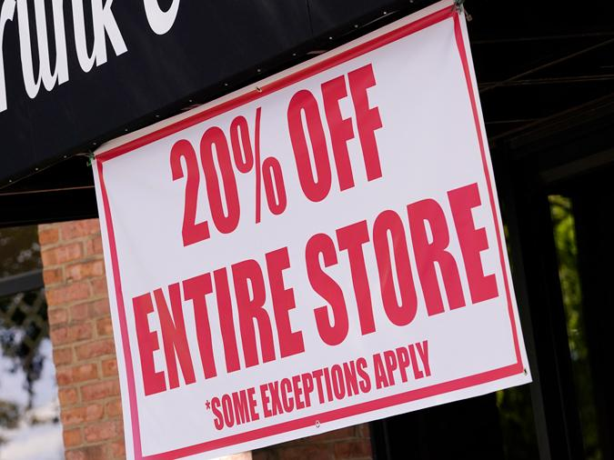 This Oct. 1, 2020 photo shows a sale sign is posted outside a store in Nashville, Tenn.