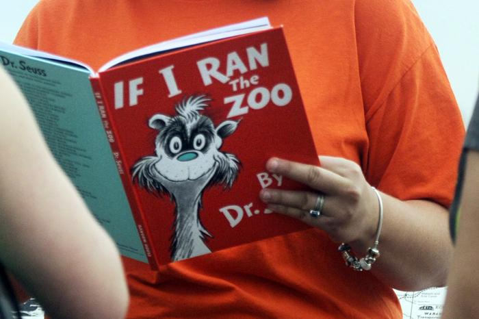 """Courtney Keating, education coordinator of The Literacy Center in Evansville, Ind., reads """"If I Ran the Zoo,"""" By Dr. Seuss."""