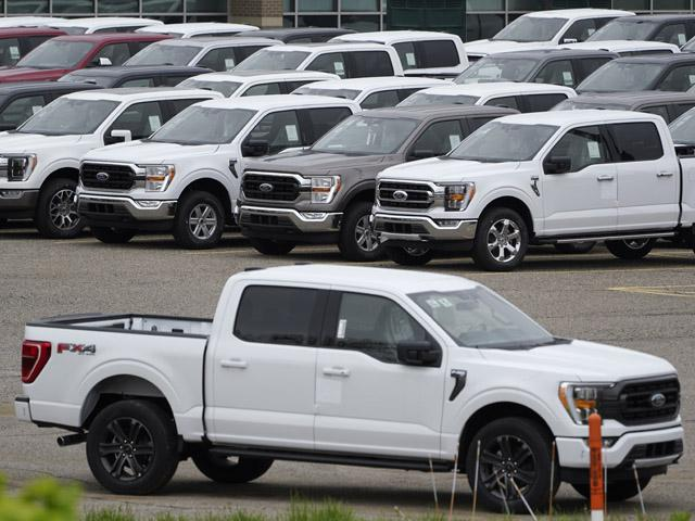 Ford pickup trucks built lacking computer chips are shown in parking lot storage in Dearborn, Mich., Tuesday, May 4, 2021