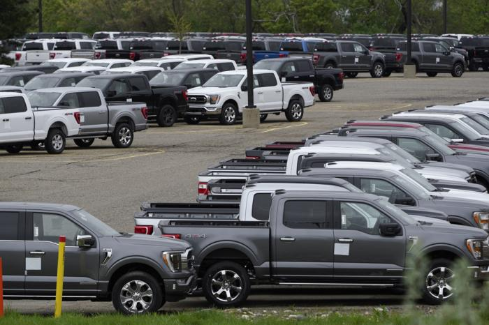 Ford pickup trucks built lacking computer chips are shown in parking lot storage in Dearborn, Mich., Tuesday, May 4, 2021. Automakers are cutting production as they grapple with a global shortage of computer chips, and that's making dealers nervous.